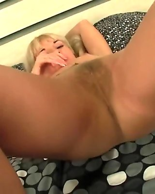 Cute Blonde Shows Hairy Pussy Through Tan Pantyhose