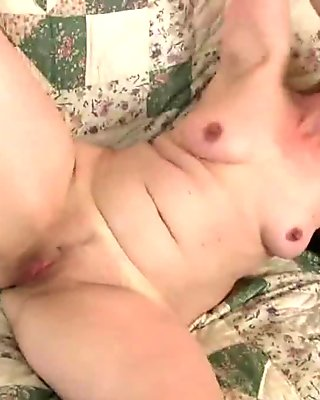 Fuckable mom masturbates in black pantyhose
