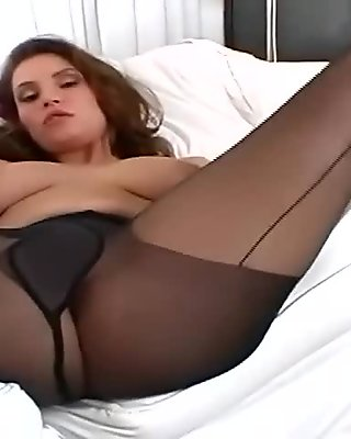 Pretty brunette with big tits teasing and rubbing her pussy in pantyhose