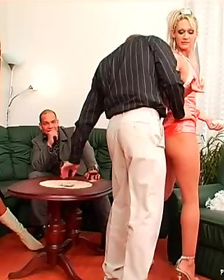 Arousing blond stripper gets banged in doggy pose in front of mature couple