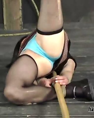 Chick wearing ripped pantyhose licks master's boots and he fucks her with long stick