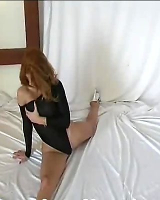 Flexible Redhead in nylon dress (clip)
