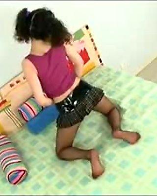 Cute schoolgirl in sexy sheer pantyhose
