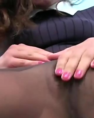 Savoury babe looks arousing in black hose