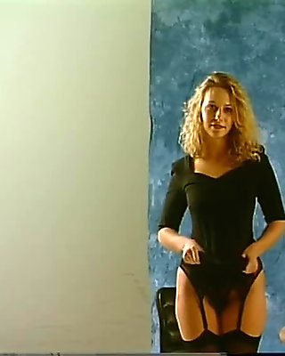 Cute Blonde Poses in Black Stockings