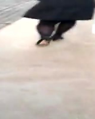 Lady in opaque pantyhose walking