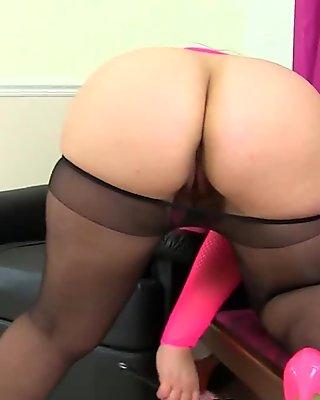 British milf Louise Bassett is fingering her nyloned pussy