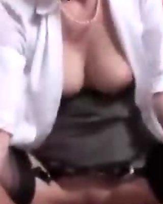 Mature in stockings sucking cock