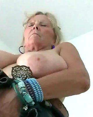 Grandma with big tits masturbates