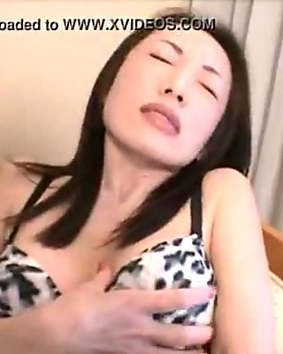 Lady rubs her tits as she masturbates her pussy using her sex toy