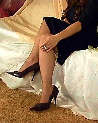 Fetish model Kymberly Jane posing in pantyhose
