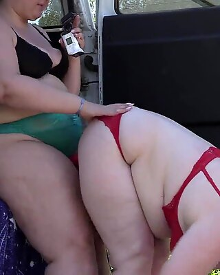 Voyeur spying on two fat lesbians who make a sex film near the car. Mature girlfriends with big asses behind the scenes. Fetish outdoors.