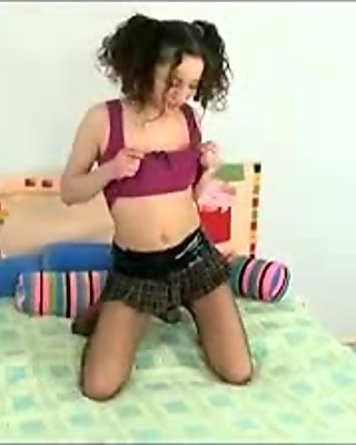 Brunette Teen Toys In Her Pantyhose On The Bed