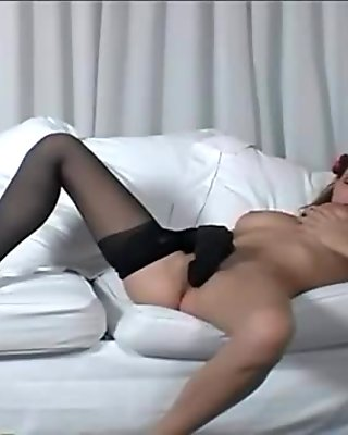 Brunette with big tits rubbing her pussy