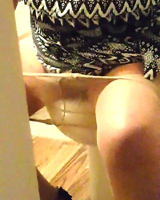 caught with door open peeing