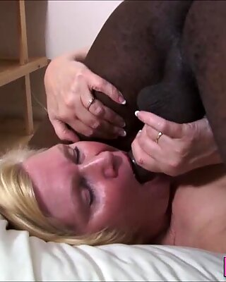 Mature granny takes hard black pole