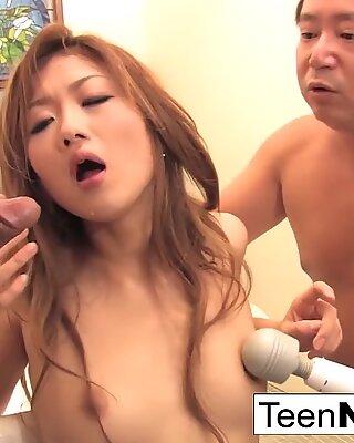 Asian sucks while getting dildo fucked