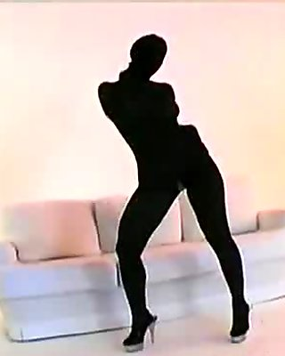 Nylon babe spreading her ass