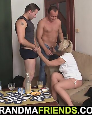 Cock-hungry blonde mommy swallows two cocks