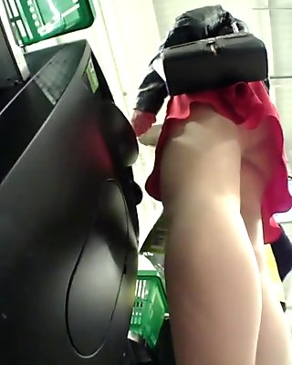 Girl at store checkout Upskirted in Nude Tights