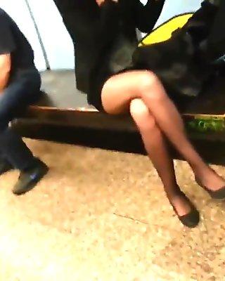 Miniskirt and black sheer pantyhose.