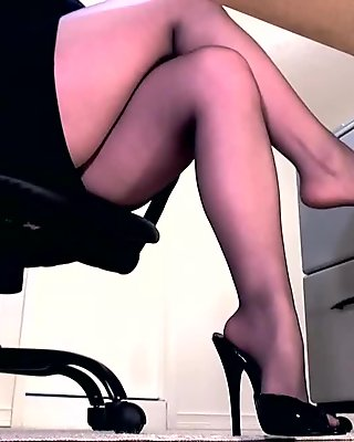 Sexy legs in pantyhose and peeptoe mule dangle