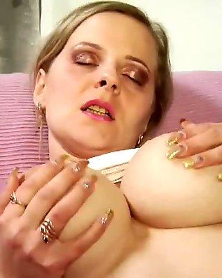 Busty MILF sucking cock in pantyhose