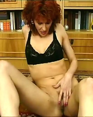 Horny milf poses for the camera and then fucks