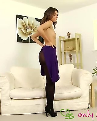 Mesmerizing curly brunette teases in super-hot pantyhose