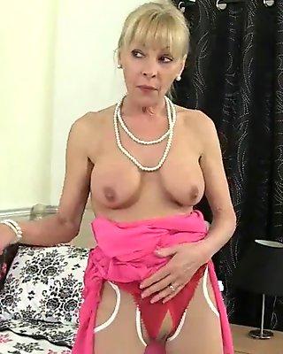 British granny Georgie fucks a dildo