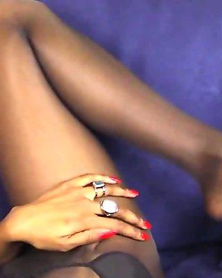 Pantyhose ebony babe teases