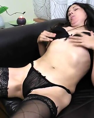 Mature mother fucks her ass and hairy pussy with fingers