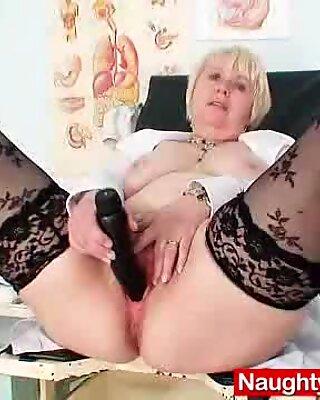 Huge boobies older madam in uniform masturbates bushy