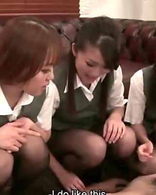 Three office ladies are foot fucking the weirdo's erect pecker