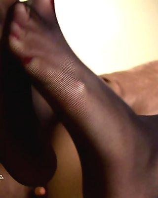 Sunny Leone in black pantyhose