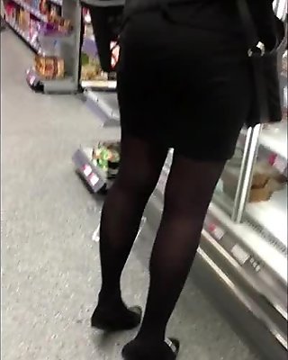 Tight short skirt girl on her toes