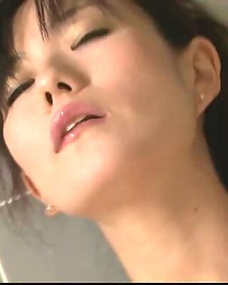 Milf Manami Komukai gobbles cock in the shower