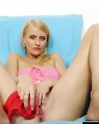 Gorgeous Kasia stuffs her pussy with red nylons
