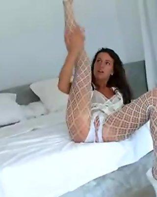 Killer brunette in white dildoing pussy