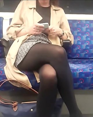 Black opaque pantyhose girl in metro