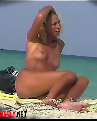 A nude beach voyeur video presents some hot pussies, asses and cocks