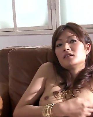 Mature asian masturbating with vibrating egg
